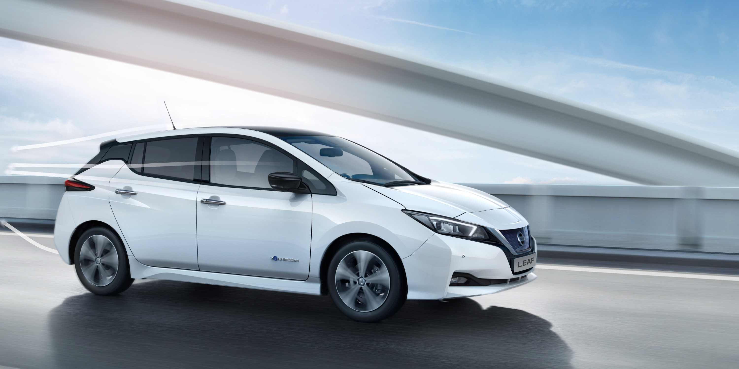 New Nissan LEAF driving on a bridge with graphic lines moving over it showing aerodynamics